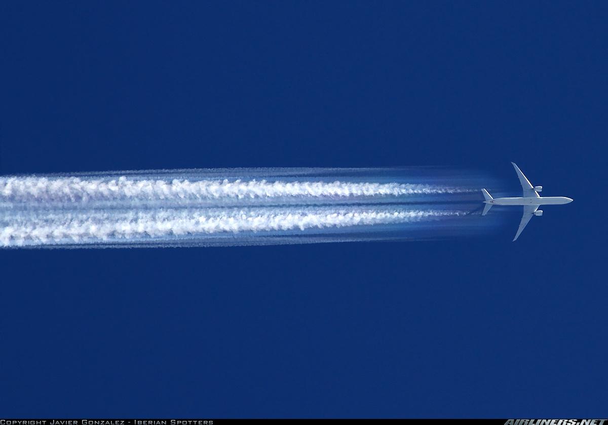 0 773ER Etihad ETK Aerodynamic CONTRAIL Cruising over Barcelona 0929 2013.png