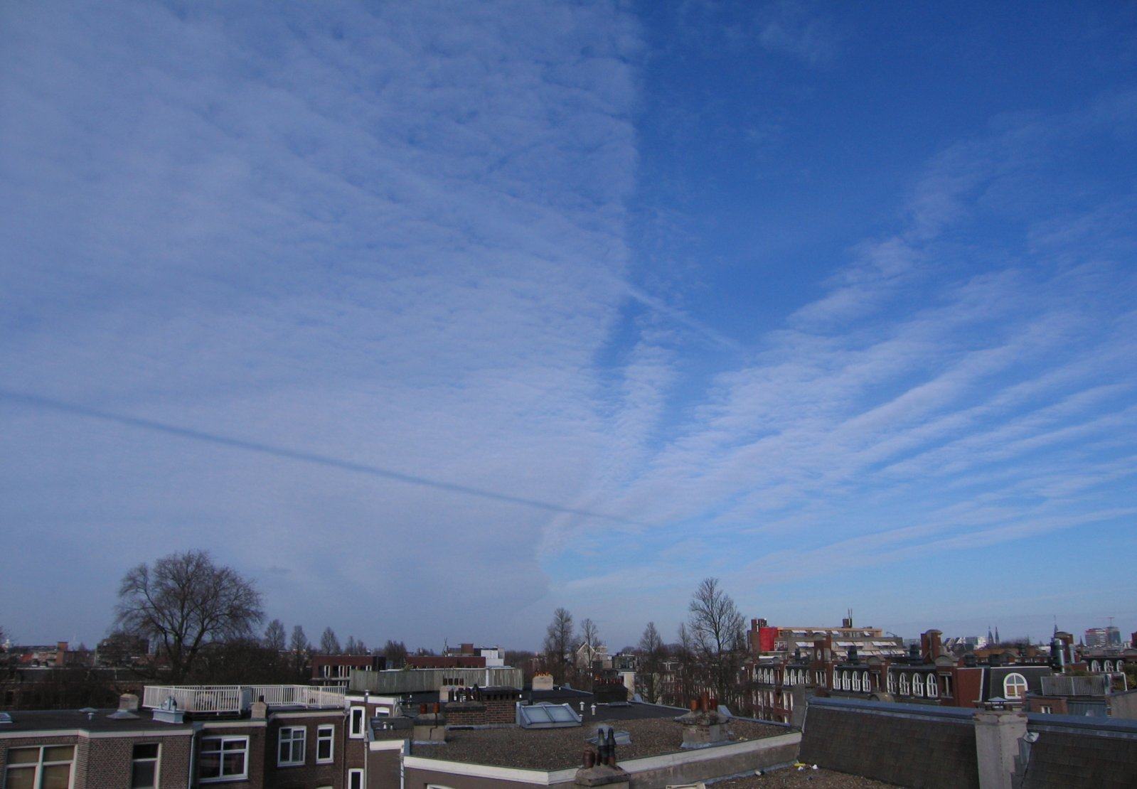 Cloud front and shadow contrail.jpg