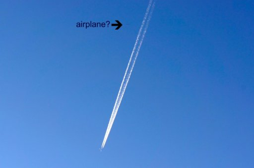 Jet with contrails.jpg