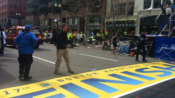 He is at the finish line the same location as the truck and the blast