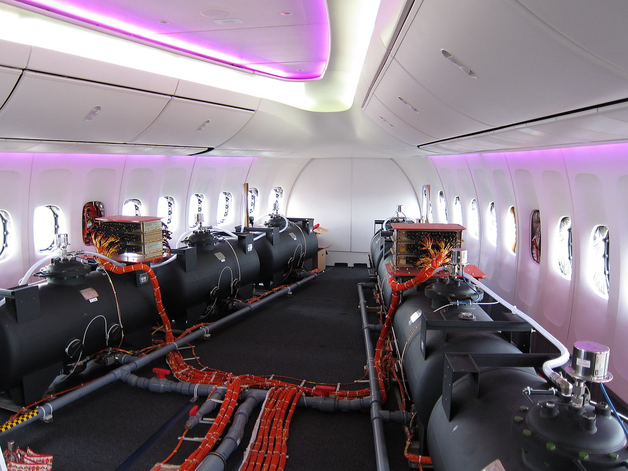 Note the overhead  mood  lighting is a different color and the photo is at a slightly different angle allowing you to see where some wiring for test ... & Debunked: Chemtrail Plane Interior (Ballast Barrels) | Metabunk azcodes.com